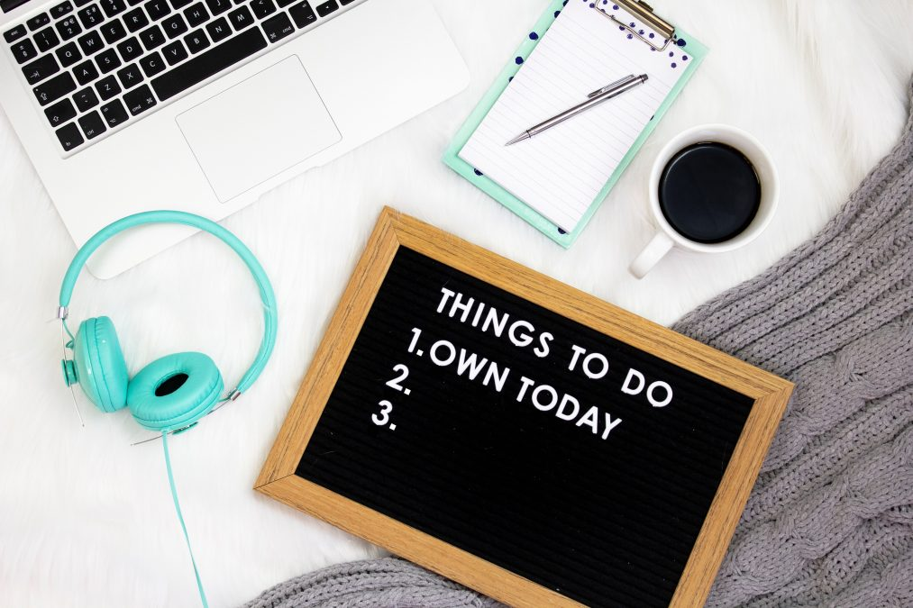 Things to do 1. Own today printed frame beside teal headset