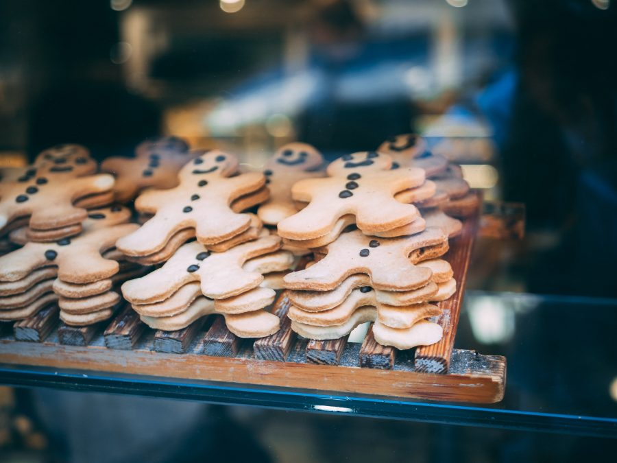 A stack of gingerbread cookies in a bakery window